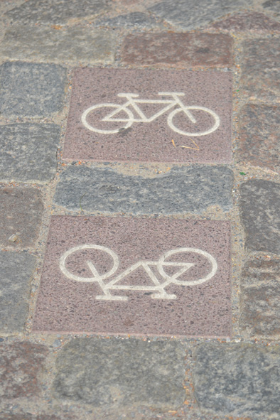 marking bicycle paths in old cobble stones