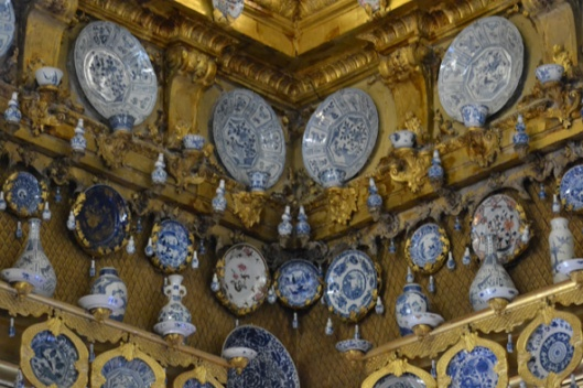 this room is filled with porcelain in all shapes and sizes